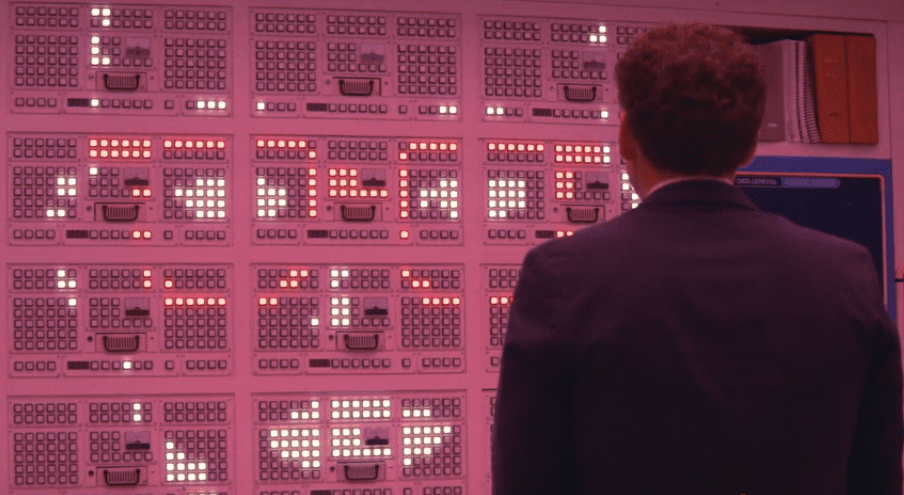 Jonah Hill as Owen Milgrim, staring at the computer face in Maniac