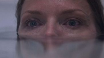 michelle pfeiffer in a bathtub water up to her nose, fear in her eyes