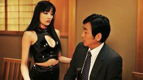 A Chinese man is approached by a young girl in a black latex dress