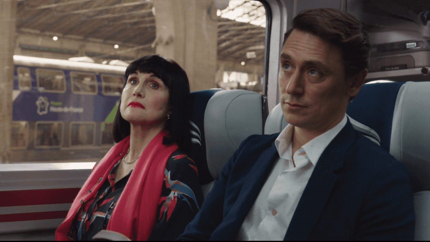 Candace and Jack sit on a train attentive to the conductor's announcement adele anderson jj feild candace jack the romanoffs