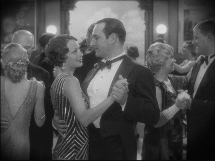 Jean Dujardin dances with a female in a ballroom set in the 1920s in The Artist