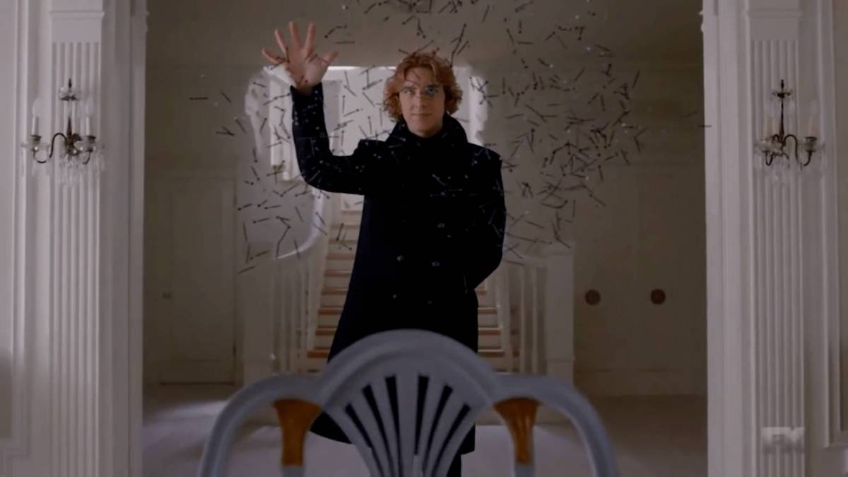 Codey throws thousands of pieces of paper in the air in AHS apocalypse