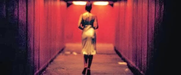 a woman walks down a dark underpass in Irreversible, Gaspar Noe