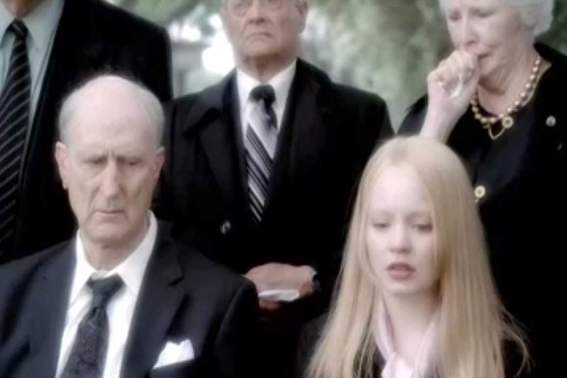 Older versions of George and Claire at a funeral