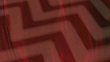 The image of the red room chevron floor pattern, layered with the red curtains.