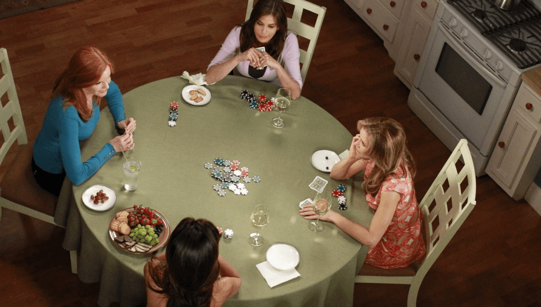"Bree, Susan, Gabrielle, and Lynette all playing their final game of poker in the Desperate Housewives finale ""Finishing the Hat"""