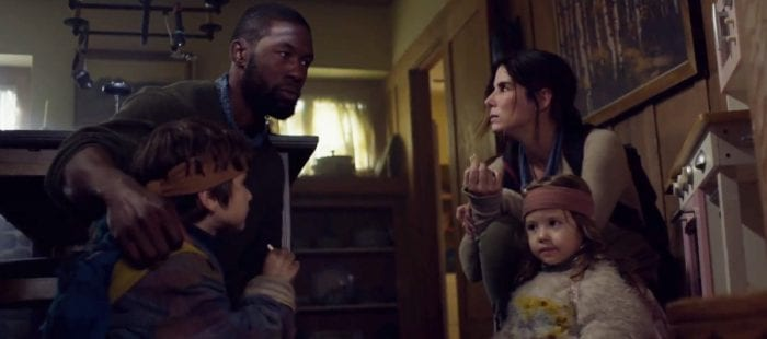 Sandra Bullock and Trevante Rhodes sharing a tense moment in Bird Box.