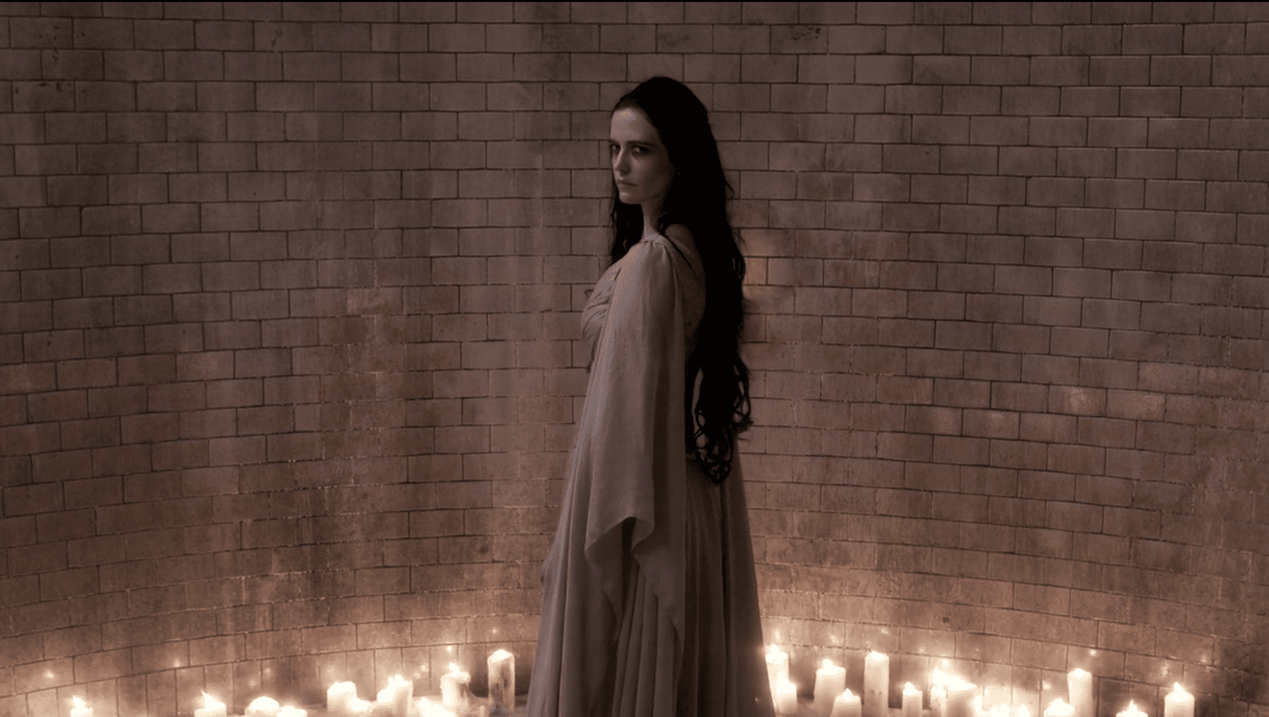 Vanessa (Eva Green) stands in an illuminated chamber as Ethan (Josh Harnett) approaches in the Penny Dreadful season 3 finale