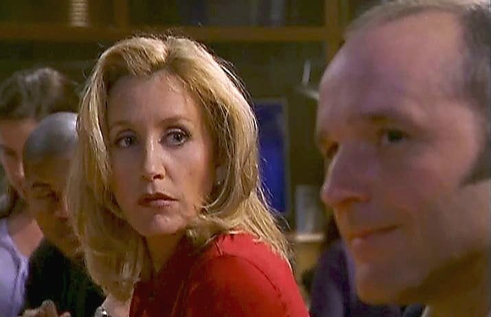 Scene from SPORTS NIGHT series finale featuring Felicity Huffman and Clark Gregg