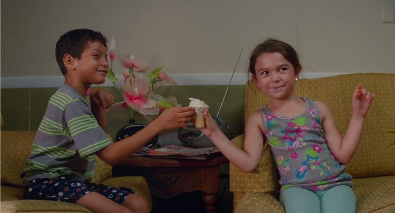 a young boy and girl share an ice cream in The Florida Project