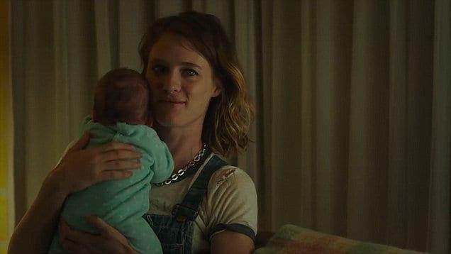 Mackenzie Davis stars as the titular Tully, cuddling a new born baby