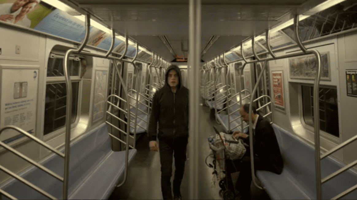 A random man on the subway plays discordant music on his keyboard as Elliot (Rami Malek) freaks out in USA's Mr. Robot
