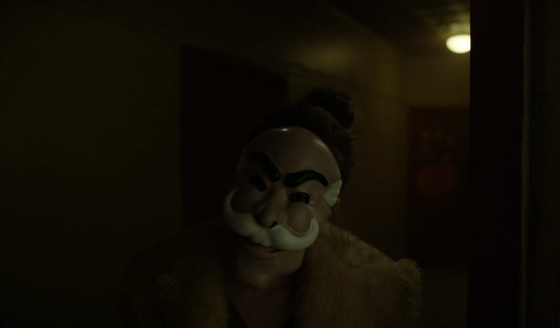 "Darlene (Carly Chaikin) wears the mask from ""The Careful Massacre of the Bourgeoisie"" as she greets Elliot (Rami Malek) in USA's Mr. Robot"