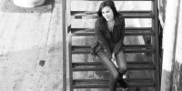 nadja dajani sitting on steel stairs outside