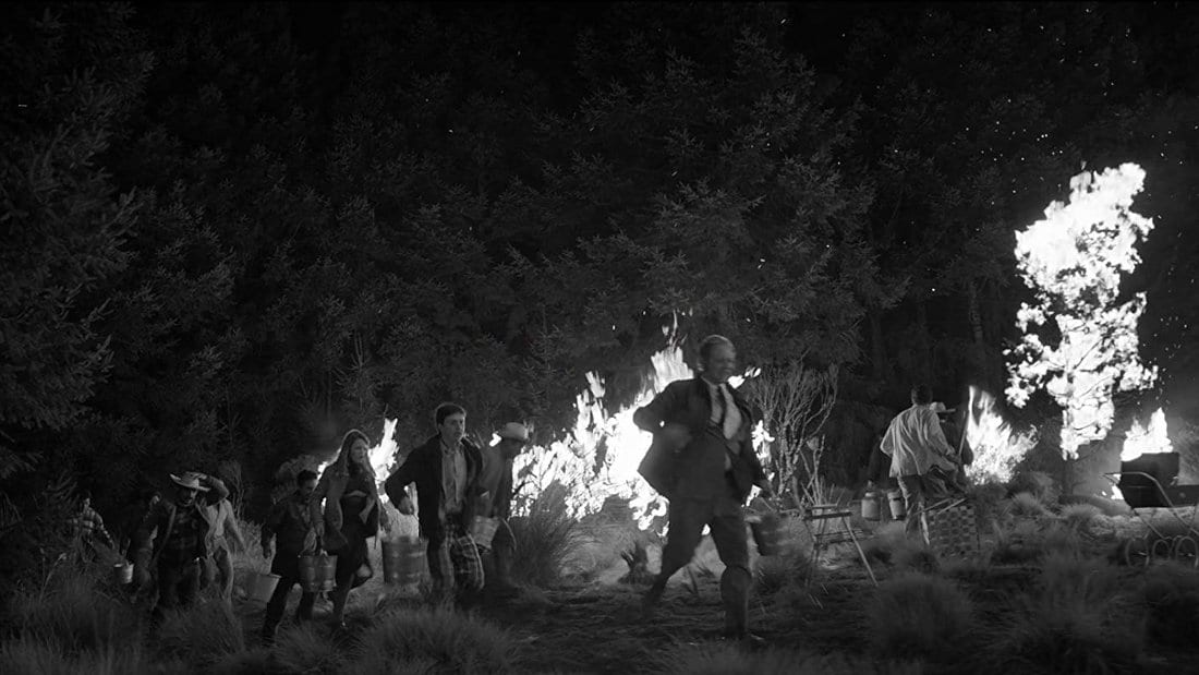 A fire rages in this still from Roma.