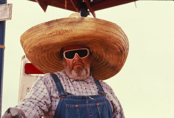 Emmet Walsh wearing the biggest straw hat in the world, and goggles