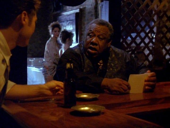 Chino Williams as Fats sitting at the bar