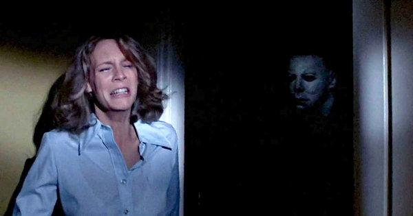 Jamie Lee Curtis hiding from Michael Myers in the original Halloween movie