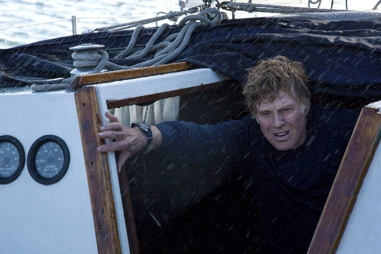 Robert Redford  on a small boat on the sea in a storm in J. C. Chandor's All Is Lost