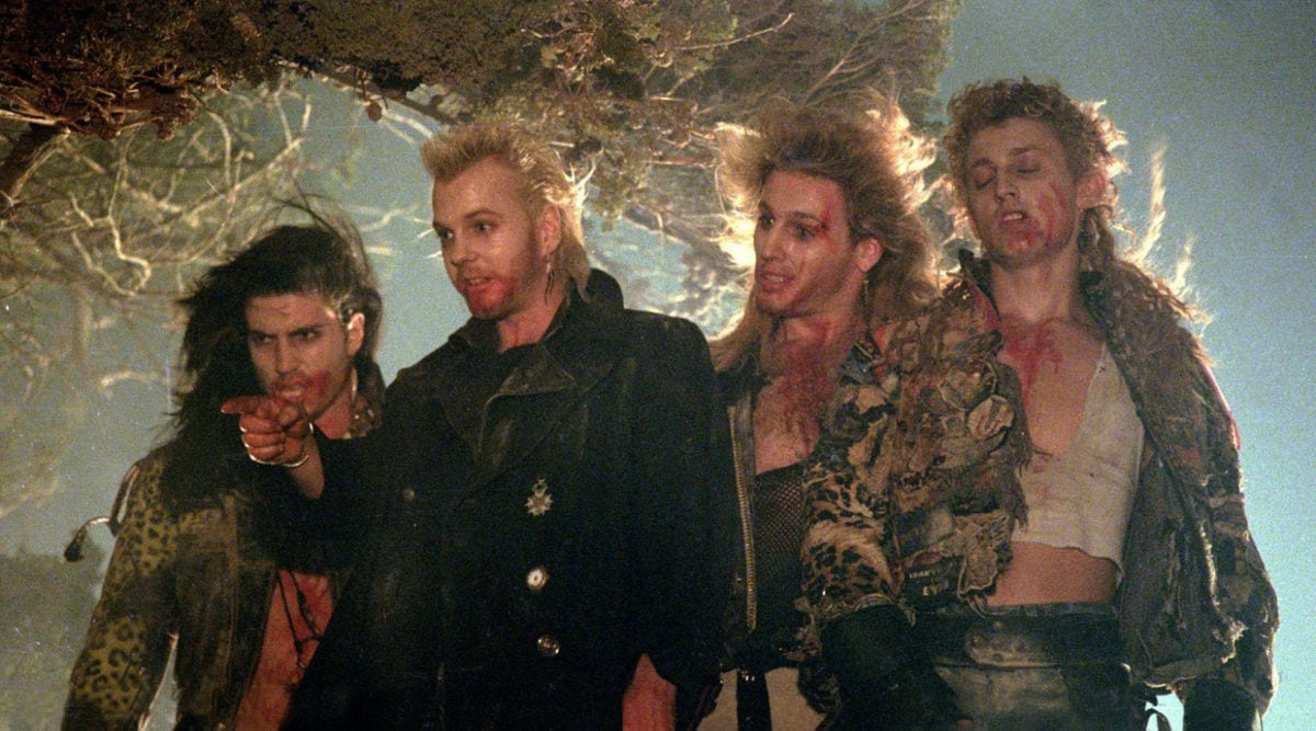 Four stand in a row dirty in The Lost Boys