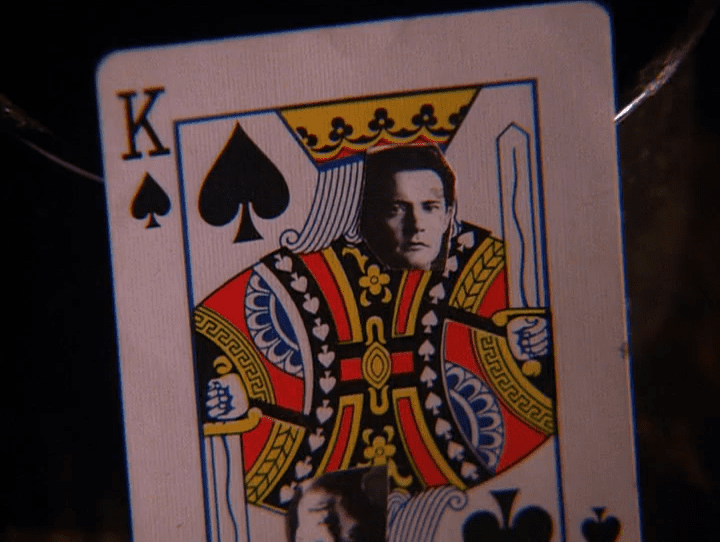 Cooper's face cut out and stuck on a King of Spades card