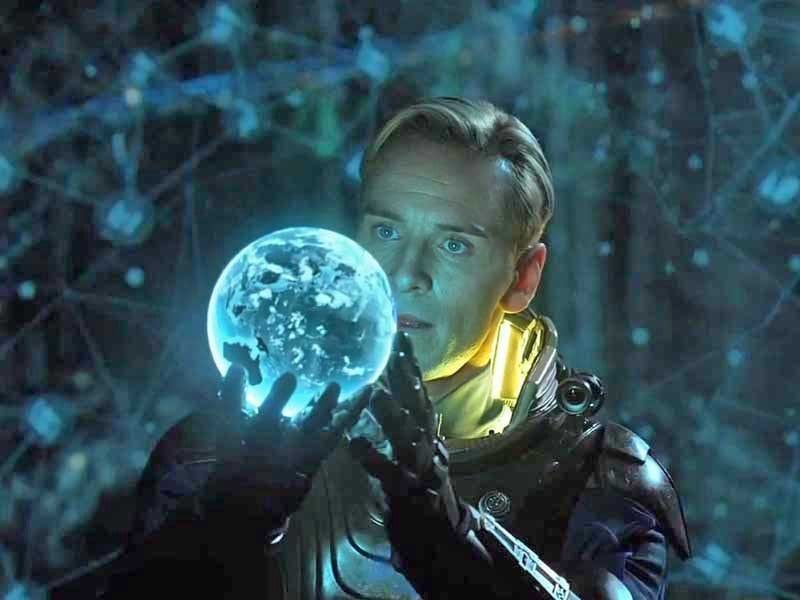 a man holds a glowing blue sphere and gazes into it