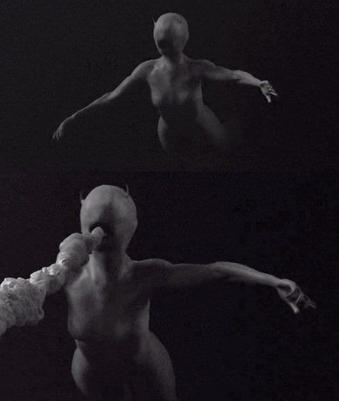 The experiment figure from Twin Peaks, an androgynous human shaped, but with no eyes, nose or ears, just a mouth spewing white fluid, arms bent backwards and floating in the darkness
