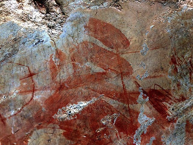 red painting on a rock face