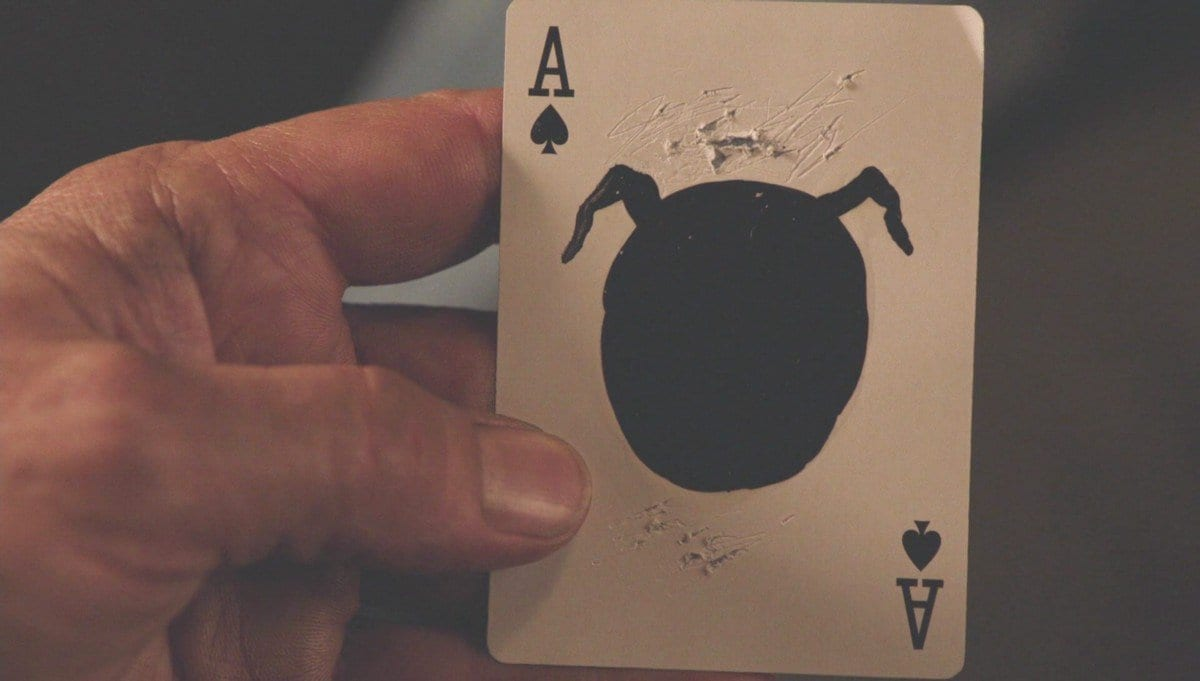 Ace playing card shows a black orb with ears