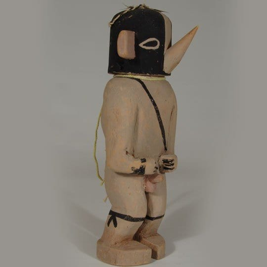 Hopi kachina doll carved from wood with a long nose and erect penis