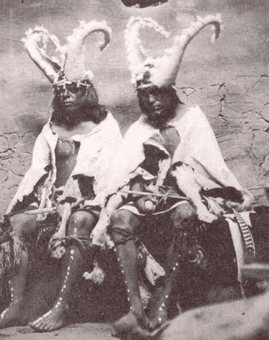 a photograph of Hopi Kachina dancers early 1900s