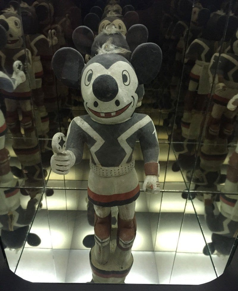 Tusan doll which looks like Mickey Mouse painted in red white and blue