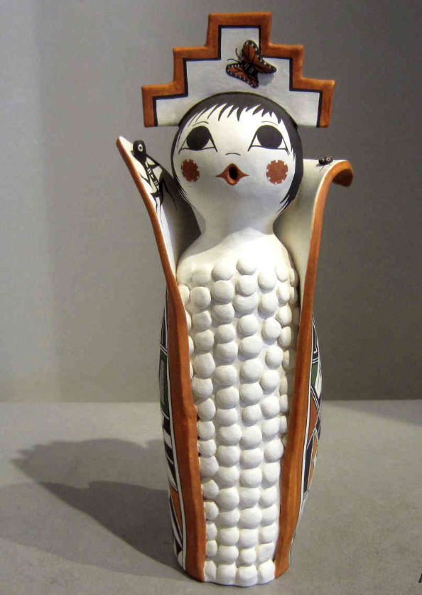 a figurine of a female figure as corn wrapped up