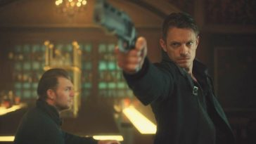 Kovacs aims a gun off screen in Altered Carbon