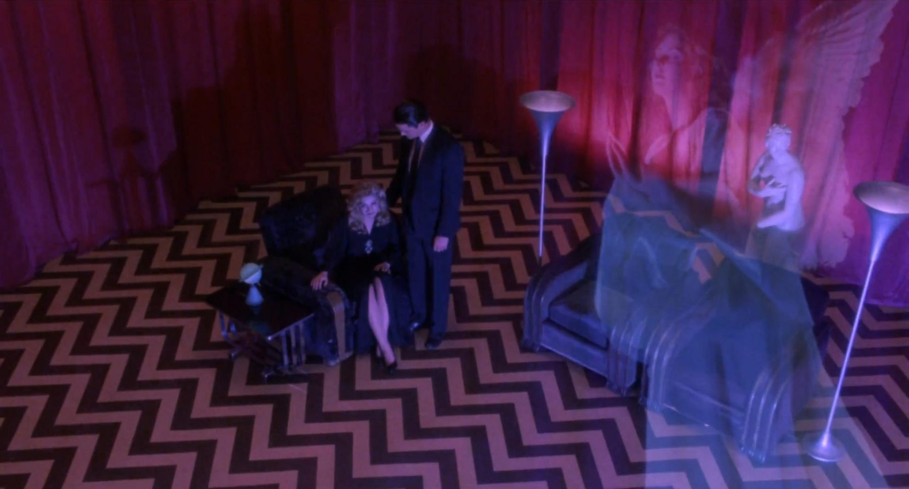 Laura Palmer and Dale Cooper in the black lodge. Laura's angel appears to her