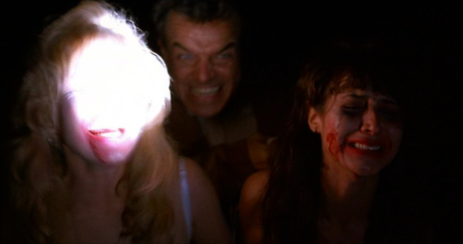 Leland Palmer leads Laura Palmer and Ronette Pulaski crying, to the Train Car in Fire Walk With Me