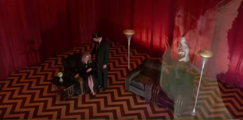 An angel appears in the Red Room as Cooper consoles Laura