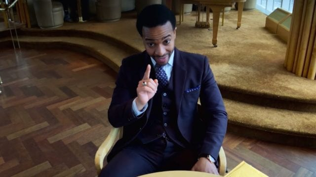 Ray Burke (Andre Holland) raises his finger to make a point