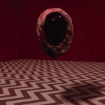 a circular nugget with black insides floating in the black lodge
