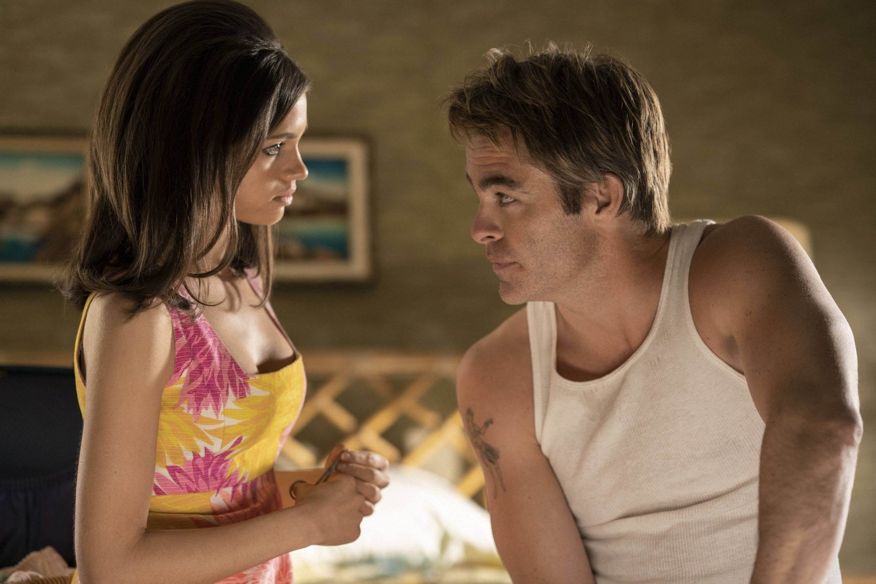 India Eisley and Chris Pine as Fauna Hodel and Jay Singletary interact in I Am the Night