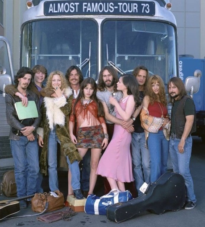 Stillwater and and their groupies pose for a picture in front of the tourbus.