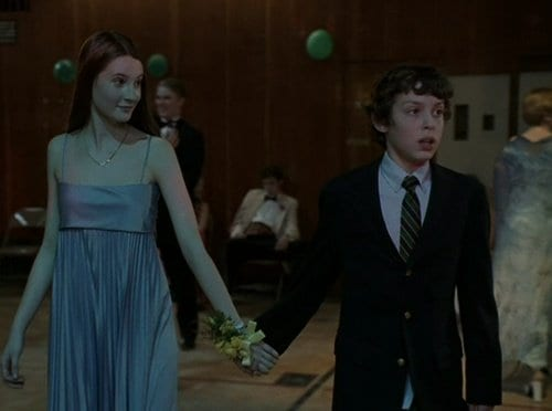Sam takes Cindy's hand as the walk to the dance floor in the Freaks and Geeks pilot episode