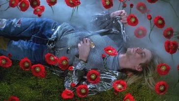 Kurt Cobain lying in poppies, still from Montage of Heck