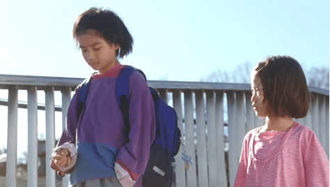 Kairi Jo as Shota and Miyu Sasaki as Yuri in 2018's Shoplifters
