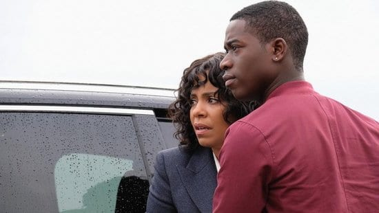 "Nina (Sanaa Lathan) and her son Dorian (Damson Idris) look on in fear at a police officer who won't leave them alone in The Twilight Zone ""Replay"""