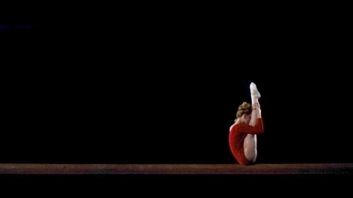 A gymnast in Ichikawa's sprawling Tokyo Olympiad