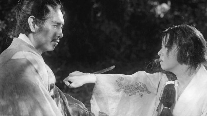 The Samurai and his Wife share a moment in Akira Kurosawa's Rashomon