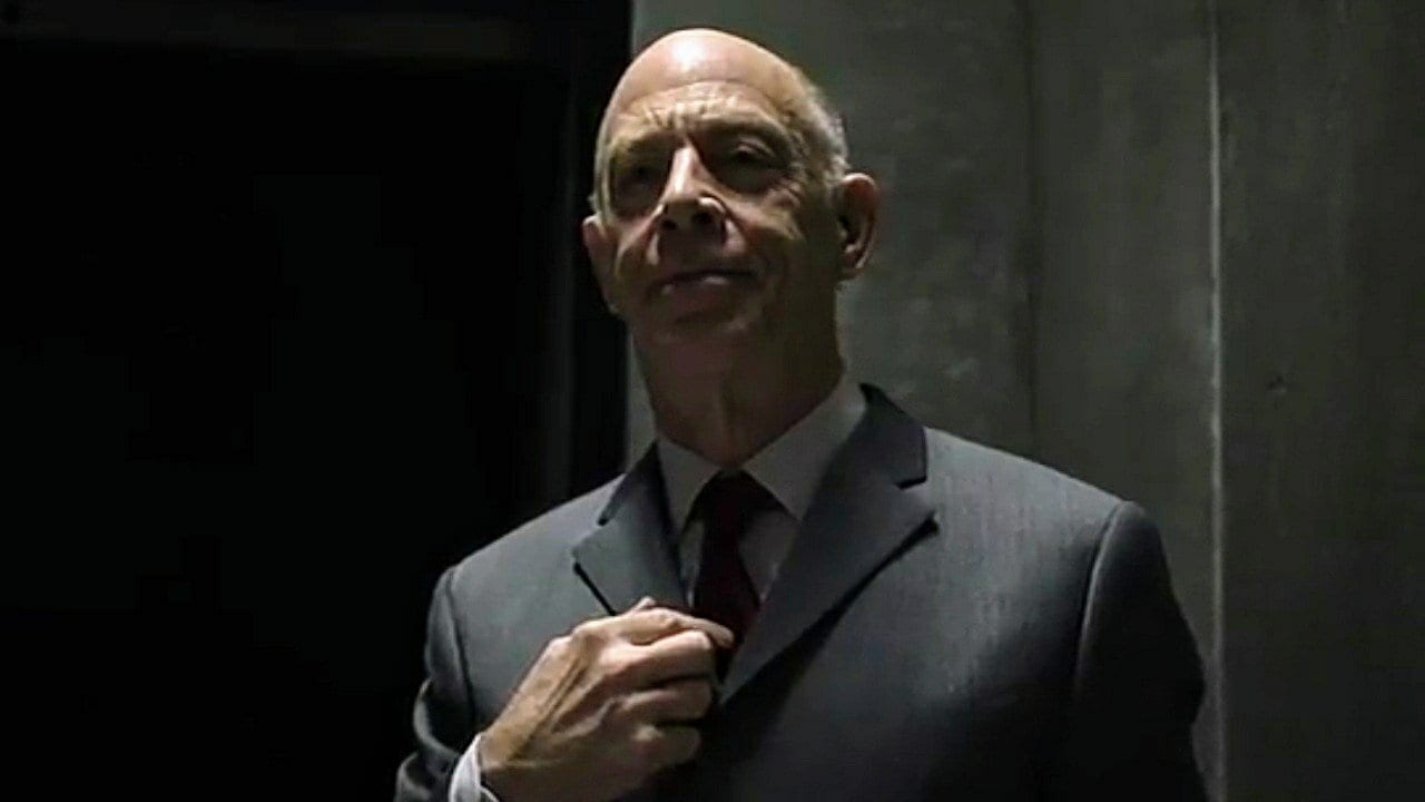 Counterpart - Howard points out a spot on his counterpart's tie