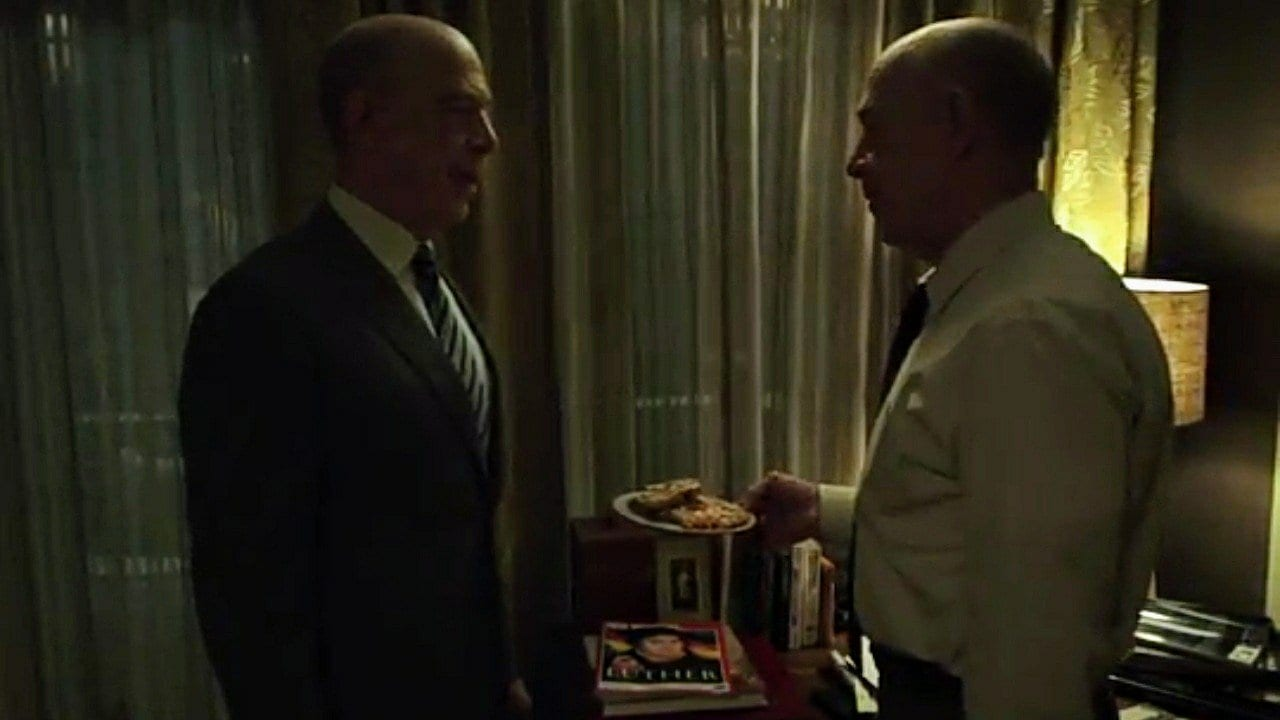 Counterpart - Howard tries to get Howard Prime to try something from the bakery downstairs