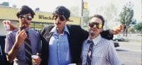 The Beastie Boys share a candid moment on set of their Sabotage video.